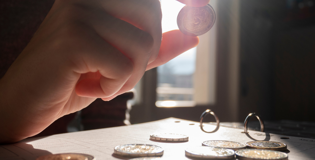 inspecting coin in day light